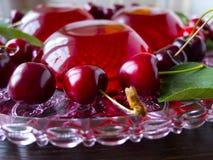 Summer refreshing dessert - red berries jelly with cherries Stock Image