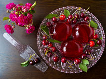 Summer refreshing dessert - red berries jelly with cherries Royalty Free Stock Photos