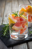 Summer refreshing drink with grapefruit and rosemary. Stock Images