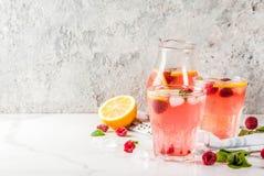 Raspberry mojito or lemonade. Summer refreshing drinks, fruit and berry raspberry mojito or lemonade with fresh mint, frozen raspberries, slices of lemon, ice Stock Photo