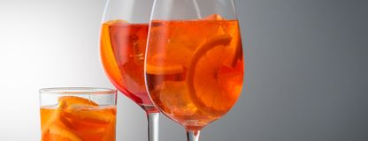 Summer refreshing faintly alcoholic cocktail Aperol spritz in a. Trendy popular Italian drink Summer refreshing faintly alcoholic cocktail Aperol spritz in a royalty free stock photo