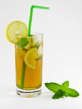 Summer refreshment. Cool green tea with lemon and fresh mint royalty free stock images