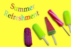 Summer refreshment with colorful letters and five ice cream on the yellow surface. royalty free illustration