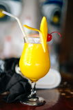 Summer refreshment drink mango shake with cherry in the glass Stock Photo
