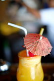 Summer refreshment drink orange shake with cherry in the glass Royalty Free Stock Photos