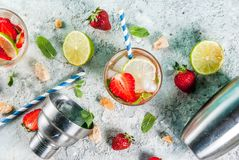 Summer refreshment drink, strawberry mojito cocktail on light co. Ncrete background, copy space royalty free stock photos