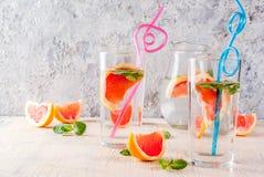Summer refreshment grapefruit drink. Summer refreshment detox water drink with Pink grapefruit and fresh mint, spa fruit water, lemonade or jin tonic cocktail Stock Images
