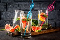 Summer refreshment grapefruit drink. Summer refreshment detox water drink with Pink grapefruit and fresh mint, spa fruit water, lemonade or jin tonic cocktail Royalty Free Stock Photography