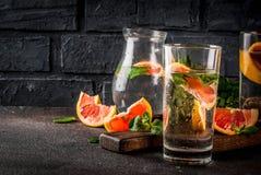 Summer refreshment grapefruit drink. Summer refreshment detox water drink with Pink grapefruit and fresh mint, spa fruit water, lemonade or jin tonic cocktail Royalty Free Stock Photo