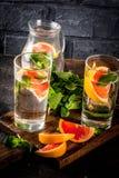 Summer refreshment grapefruit drink. Summer refreshment detox water drink with Pink grapefruit and fresh mint, spa fruit water, lemonade or jin tonic cocktail Stock Image