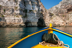 Summer relax. Sailing with a Maltese boat to the Blue Grotto Royalty Free Stock Image