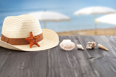 Summer, and relax. Summer, hat, seashells on table Stock Photo
