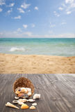 Summer, and relax. Summer, hat, seashells on table Royalty Free Stock Photos