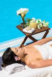 Summer relax in Spa. Woman relaxing and sunbathing in spa club at poolside in summer Stock Image