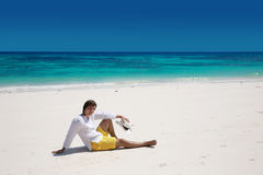 Summer. Relax. Successful handsome man resting on exotic beach w Stock Photo