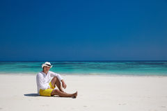 Summer. Relax. successful man resting on exotic beach. Vacation Royalty Free Stock Images