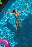 Summer Relax. Woman Floating, Swimming Pool Water. Summertime Holidays Stock Image
