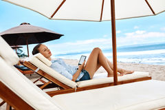 Summer Relaxation. Woman Reading, Relaxing On Beach. Summertime Stock Image