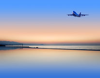 Summer resort. Romance summer resort in the morning and flying up airplane Stock Photography