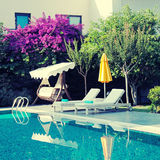 Summer resort with outdoor furniture near the swimming pool Royalty Free Stock Photos