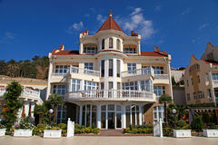 Summer resort villa with classical white balconies Stock Photos
