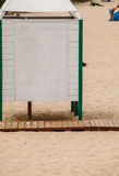 Summer resort. White dressing cabin on a sandy beach. Stock Photography