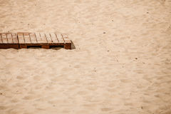 Summer resort. Wooden sidewalk on a sandy beach. Stock Image