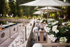 Summer restaurant terrace. Near pond Royalty Free Stock Image