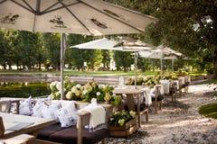 Summer restaurant terrace. In park near pond Stock Photography