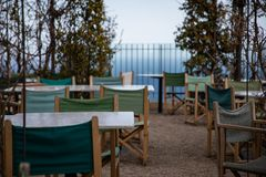 Summer restaurant terrace on shore with sea views stock photography