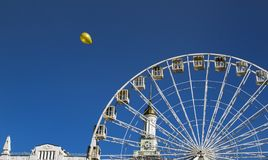 Yellow ball and ferris wheel royalty free stock images