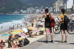 Summer in Rio has crowded beaches and enhanced policing Stock Photo