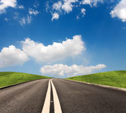 Summer road. Driving on the long Road in nature Royalty Free Stock Image
