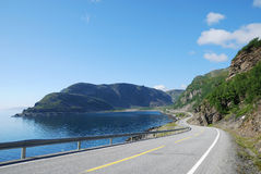 Summer road along the coast of Mageroya. Stock Images