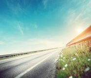 Summer road, sky, sun and clouds royalty free stock photo