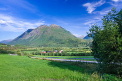Summer road to Norwegian village Royalty Free Stock Photo
