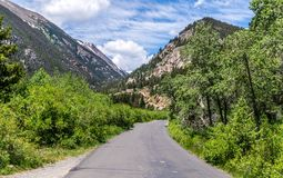 Road in the mountains in the Rocky Mountain National Park. Nature in Colorado, United States. Summer in the Rockies of Colorado, USA. Picturesque green mountains royalty free stock photos