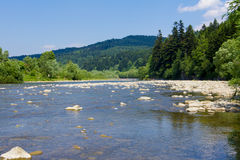 In summer rocky mountain river water silk. Mountain river royalty free stock photography
