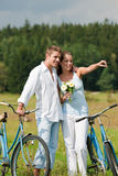 Summer - Romantic couple with bike in meadow Stock Photos