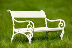 Summer - Romantic white bench in green meadow Stock Photography