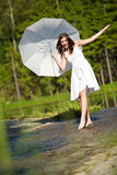 Summer - romantic woman with parasol in sunlight Stock Images