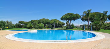 Summer-round outdoor swimming pool. Royalty Free Stock Photo