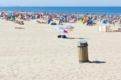 Summer Rubbish Bin. Rubbish bin on the Summer Crowded Beach of Scheveningen, Netherlands Royalty Free Stock Images