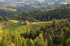 Summer rural landscape in the Carpathian mountains. Summer rural landscape above the village in the Carpathian mountains, in Moeciu - Bran, Romania Royalty Free Stock Photography
