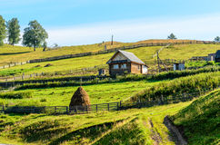 Summer rural landscape with house Stock Photo
