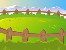 Summer, rural landscape. Lawn for pets. Fence around the corral. Landscape on the background of mountains. Sunny, clear weather. Cartoon Royalty Free Stock Images