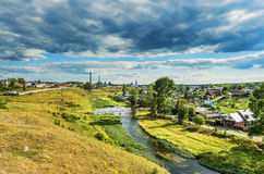 Summer rural landscape with river and clouds Royalty Free Stock Image