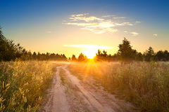 Summer rural landscape with sunrise , fog and the road Stock Photo