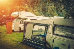 Summer RV Camper Camping. Relaxing on the Campground royalty free stock images