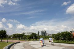 Summer's day. People walk around in the city plaza in a beautiful summer's day Stock Photos